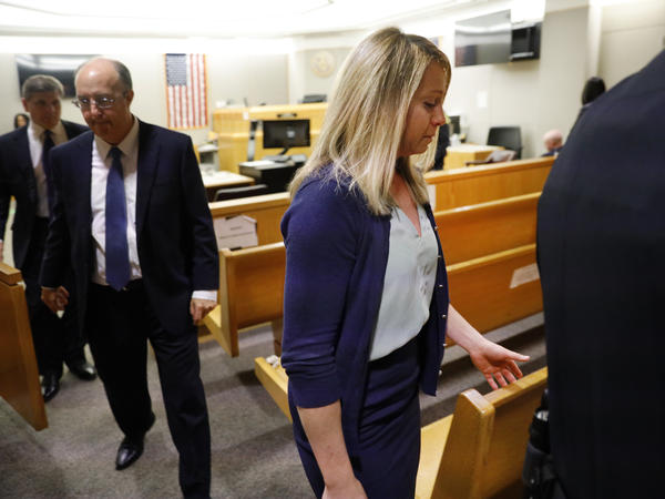 Fired Dallas police Officer Amber Guyger leaves the courtroom after a jury found her guilty of murder Tuesday. Guyger shot and killed Botham Jean, an unarmed 26-year-old neighbor, in his own apartment last year. She told police she thought his apartment was her own and that he was an intruder.