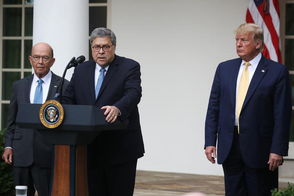 U.S. Attorney General William Barr (center) speaks during a July press conference on citizenship data with President Trump and Commerce Secretary Wilbur Ross in the Rose Garden of the White House in Washington, D.C.