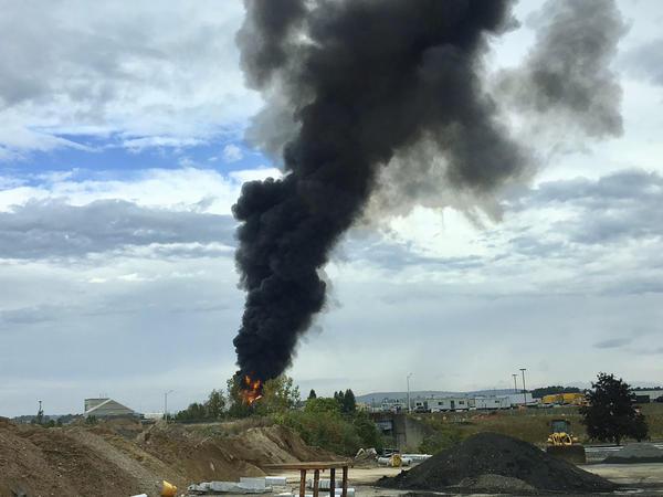 Smoke fills the sky after a World War II-era plane crashed Wednesday at Bradley International Airport north of Hartford, Conn.