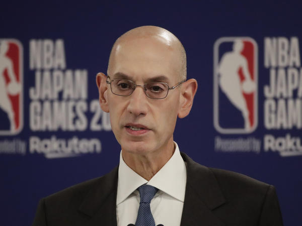 NBA Commissioner Adam Silver speaks at a news conference before an NBA preseason basketball game between the Houston Rockets and the Toronto Raptors Tuesday, in Saitama, near Tokyo.
