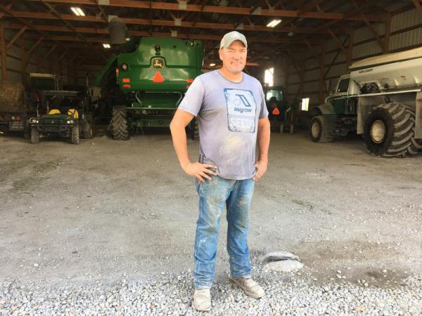 Kansas farmer Luke Ulrich faces long hours and low pay in part because of President Trump's trade policies, but he still backs Trump.