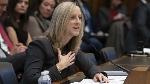 Kathleen Kraninger, director of the Consumer Financial Protection Bureau, testifies before the House Financial Services Committee on March 7. On Thursday, she faced questions from senators about problems with a student loan program for public service workers.