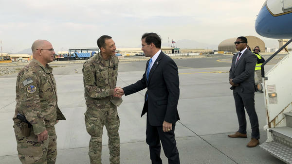 U.S. Defense Secretary Mark Esper (center), is greeted by U.S. military personnel upon arriving in Kabul, Afghanistan, on Sunday.