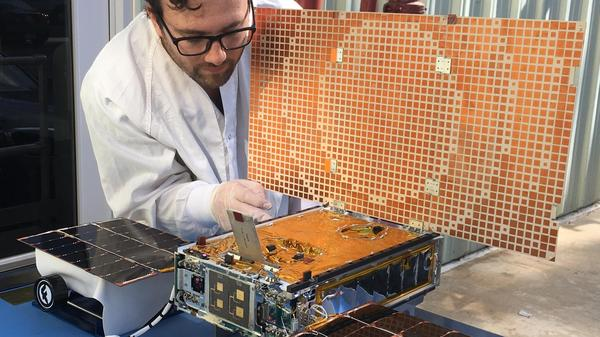 Engineer Joel Steinkraus tests solar panels on one of two CubeSats that made up NASA's Mars Cube One mission. The MarCO CubeSats — the first to be sent into deep space — flew to Mars and relayed telemetry from NASA's InSight lander.