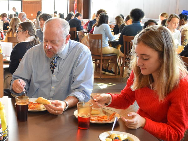 Kylie Burger (right), a University School of Milwaukee student, eats lunch with band director Dain Shuler. The school has a long-standing tradition of assigned seating at lunch. A staff member is also required to sit at each table to help facilitate conversation.
