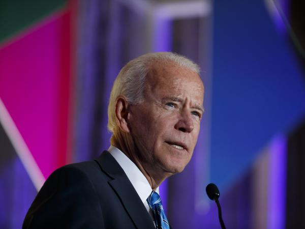 "Former vice president and current Democratic presidential candidate Joe Biden apologized on Tuesday for using the word ""lynching"" in 1998 to describe the impeachment of then-President Bill Clinton. Above, Biden speaks at this year's Democratic Women's Leadership Forum."