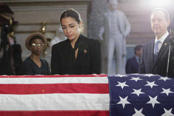 Rep. Alexandria Ocasio-Cortez, D-N.Y., stops to pay her respects at the Capitol on Thursday.