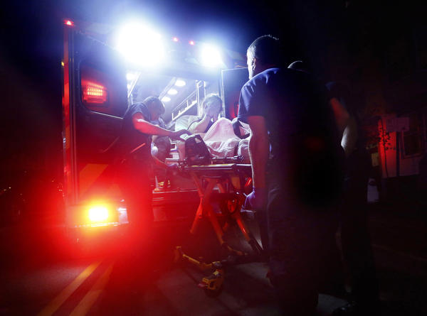 Paramedics in Portland, Maine, respond to a call for a heroin overdose. A new report estimates some $60 billion was spent on health care related to opioid addiction in 2018.
