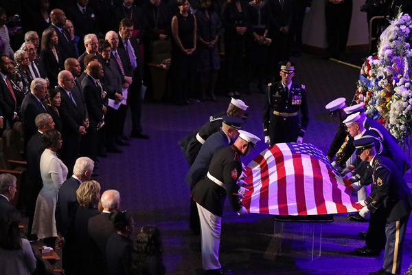 A military honor guard lays the U.S. flag on the casket of Rep. Elijah Cummings during his funeral service at New Psalmist Baptist Church in Baltimore on Friday.