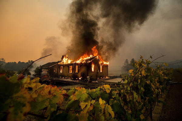 The Kincade Fire burns through the Jimtown community of Sonoma County, Calif., on Thursday.