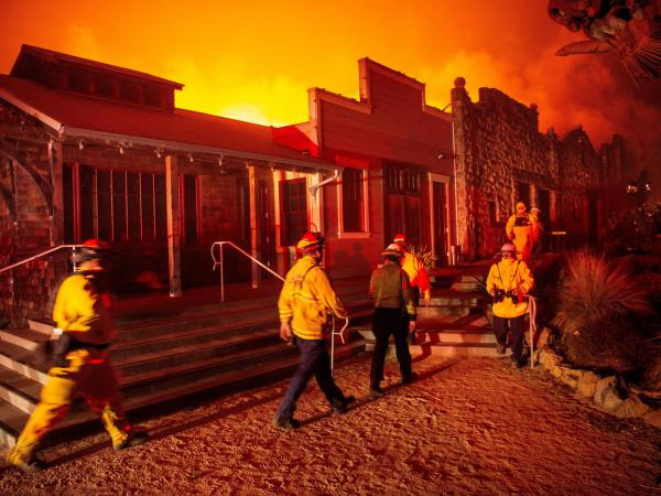 Firefighters surveyed the Soda Rock Winery as it burned during the Kincade Fire and flames raced through Healdsburg, Calif., on Sunday.
