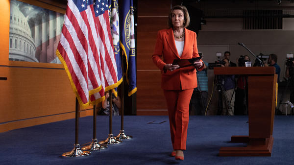 Speaker of the House Nancy Pelosi leaves her weekly press conference on Capitol Hill on Thursday as the House prepared to vote — then pass — a resolution formalizing its impeachment inquiry into President Trump.