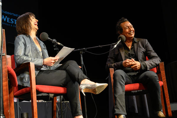 Host Ophira Eisenberg with Alejandro Escovedo on <em>Ask Me Another</em> at the Majestic Theatre in Dallas, Texas.