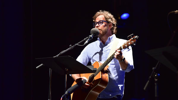 <em>Ask Me Another</em> house musician Jonathan Coulton performs at the Majestic Theatre in Dallas, Texas.