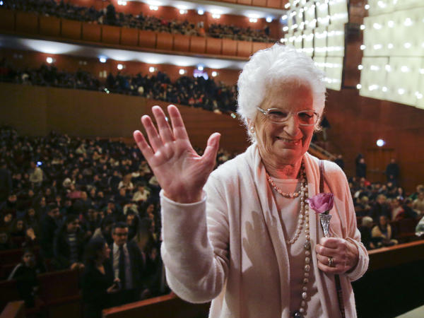 Liliana Segre waves at the end of a meeting with students in Milan, Italy, in 2018. For decades, Segre, 89, was reluctant to discuss her time in the Auschwitz concentration camp. But in the 1990s, she began speaking to schoolchildren throughout Italy about the Holocaust.