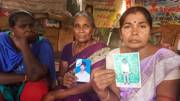 Ilagan Udaya Kumari (from left), 50, whose husband went missing; Analaxmi Ariaratnam, 70, whose son disappeared; and Sangara Pilay Vanalogini, 53, whose son went missing. Mothers and other relatives of some of the tens of thousands of people who disappeared in Sri Lanka's 26-year civil war have been protesting in Vavuniya, Sri Lanka, to raise awareness of their plight.
