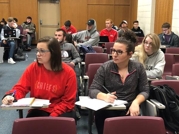 University of Central Missouri students in Jon Taylor's history class take notes during a lecture on the Great Depression.