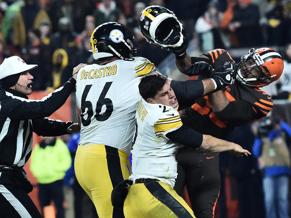 Cleveland Browns defensive end Myles Garrett hits Pittsburgh Steelers quarterback Mason Rudolph with his own helmet as offensive guard David DeCastro tries to intervene, in the final seconds of their game Thursday night.