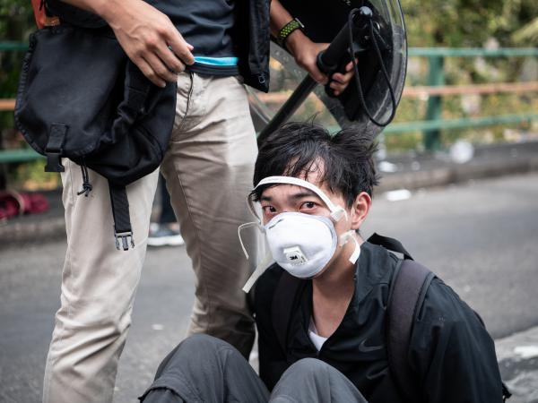 Police arrest anti-government protesters at Hong Kong Polytechnic University on Monday. Pro-democracy protesters organized a general strike last week as demonstrations in Hong Kong stretched into their sixth month.