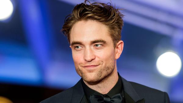 "In the late 2000s, Robert Pattinson began playing vampire Edward Cullen in the film adaptations of the <em>Twilight</em> novels. ""It was so sudden, it didn't feel real to me at all,"" he says of the fame."