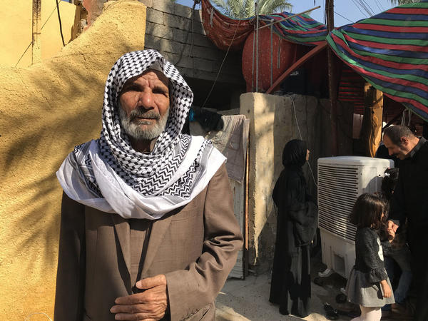 "Khazaal Salih mourns his son, Abbas Salih, a medic who was shot and killed while he was treating a wounded protester in Baghdad. ""By God, my son did nothing wrong,"" says Salih."