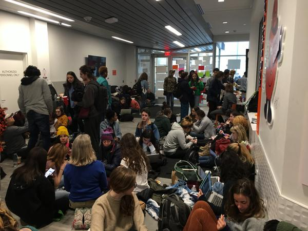 Students participate in a sit-in at the Barnes Center at SU.