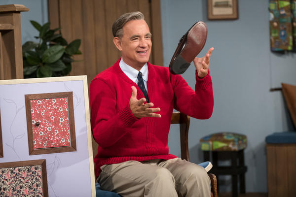"Tom Hanks stars as Fred Rogers in <em>A Beautiful Day in the Neighborhood. </em>Hanks watched a lot of<em> Mister Rogers</em> to research the role and found as an adult, you don't really ""get it"": ""Why is it taking so long? What's the big deal? What are these fish?"""