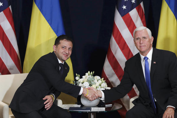 Ukrainian President Volodymyr Zelenskiy shakes hands with Vice President Pence in Warsaw, Poland, on Sept. 1.