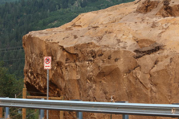 Highway 145 now passes Memorial Rock, fitted with a fence and a reminder that travelers should not stop to view it.