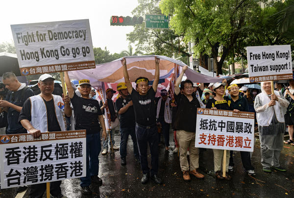 Members of the pro-Taiwan independence Taiwan Solidarity Union march in downtown Taipei in support of Hong Kong protesters demanding more freedom and autonomy from China.
