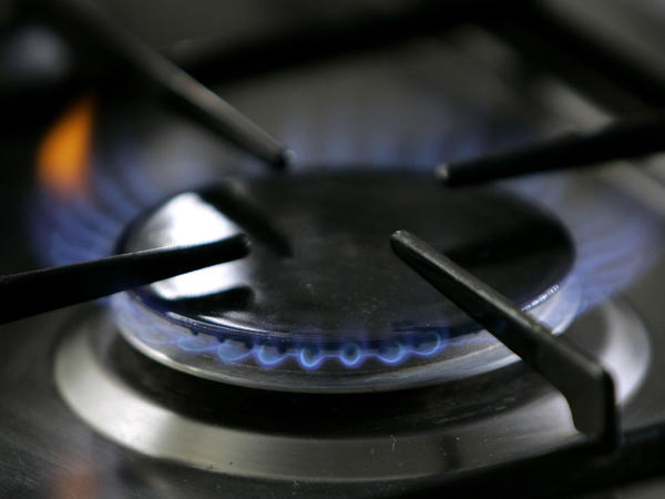 A gas-lit flame burns on a stove. A California restaurant organization is suing Berkeley over the city's ban on natural gas, which is set to take effect in January, 2020.