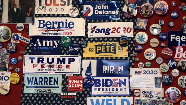 Pins and bumper stickers of presidential contenders in the New Hampshire primary are displayed in the State House visitors center in Concord, N.H.