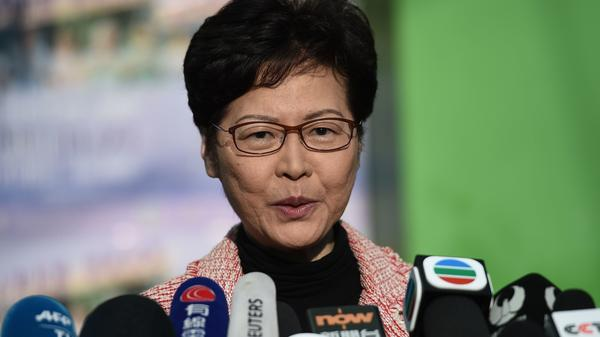 """Hong Kong Chief Executive Carrie Lam addresses the media after casting her vote during Sunday's district council elections. After results showed a landslide victory for pro-democracy candidates, Lam said she would listen """"humbly"""" to the will of the voters."""