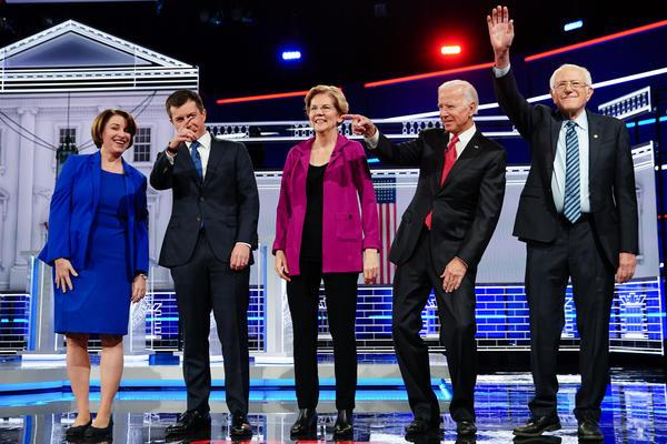 Presidential candidates Sen. Amy Klobuchar; Sound Bend, Ind., Mayor Pete Buttigieg; Sen. Elizabeth Warren; former U.S. Vice President Joe Biden; and Sen. Bernie Sanders stand onstage for the Democratic presidential debate on Wednesday.