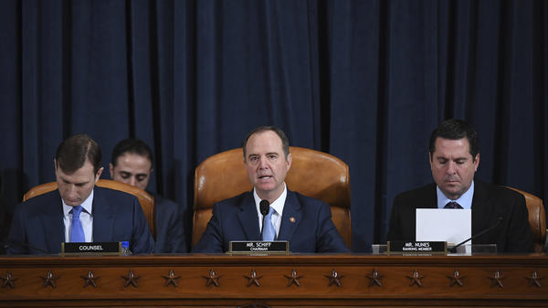 House Intelligence Committee Chairman Adam Schiff, D-Calif. (center); ranking member Rep. Devin Nunes of California (right); and committee counsel Daniel Goldman hold an impeachment inquiry hearing on Nov. 21. Schiff has released the panel's report on the inquiry.