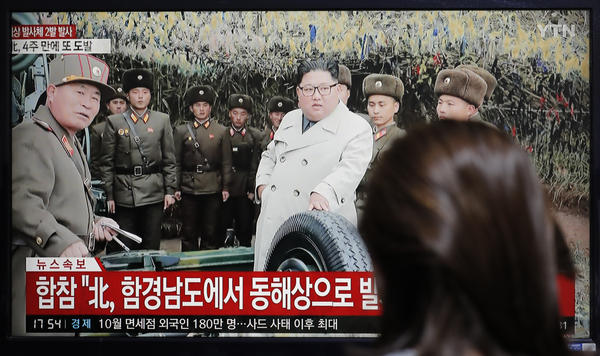 A woman watches a news program showing North Korean leader Kim Jong Un.