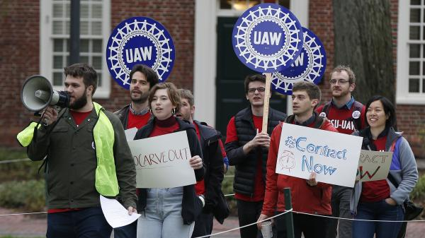 Union members protest at Harvard University in May over an increasing number of harassment and discrimination cases. The union began an indefinite strike Tuesday, with one of its key proposals aimed at strengthening protections against harassment and discrimination.