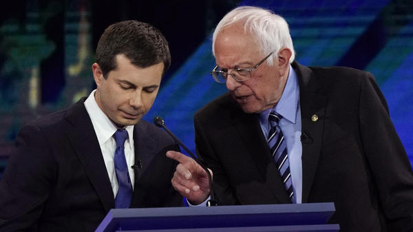 Democratic presidential candidates Pete Buttigieg (left) and Bernie Sanders have taken differing positions on how comprehensive free college plans should be, which gets at a philosophical difference over the role of government assistance.