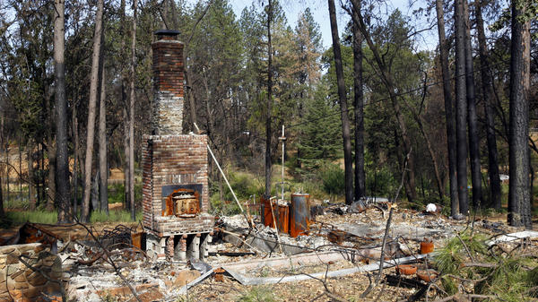 Seen in August 2019, the remains of a home destroyed in Northern California's 2018 Camp Fire.