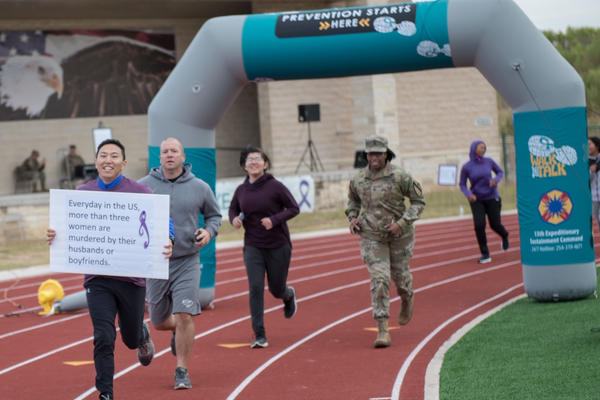 Runners participate in an Oct. 17 domestic violence awareness event at Ft. Hood, Tex.