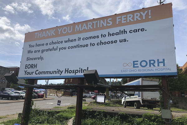 A billboard from East Ohio Regional Hospital is shown Tuesday, Sept. 3, 2019, in Martins Ferry, Ohio. The hospital and sister facility Ohio Valley Medical Center in Wheeling, W.Va., are closing after two years of ownership by Irvine, California-based Alecto Healthcare Services. (John Raby/AP)
