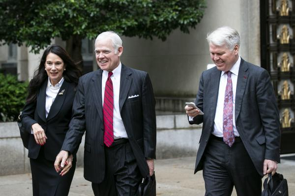 Attorney Charles Cooper, representing former national security aide Charles Kupperman (center) departs federal court in Washington in October. On Tuesday, Cooper asked a federal court to keep alive a lawsuit centered on a now-withdrawn subpoena filed by House Democrats that sought Kupperman's testimony as part of the impeachment inquiry.
