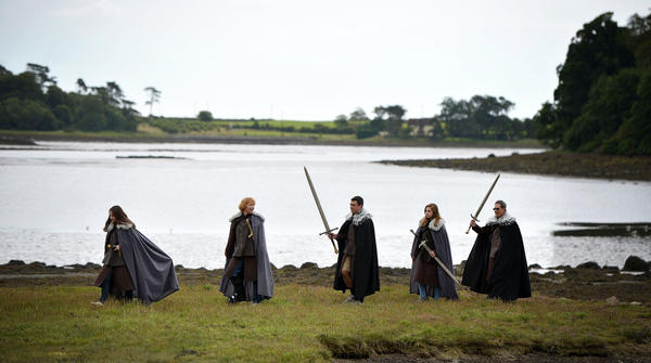 A family from Washington, D.C., participates in a <em>Game of Thrones</em> tour in Belfast, Northern Ireland, in August 2015.