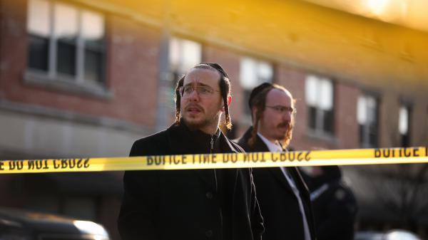 Members of the local Jewish community gather Wednesday outside the JC Kosher Supermarket in Jersey City, the site of what is now being called a potential act of terrorism.