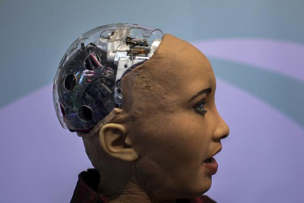 Hanson Robotics' flagship robot Sophia, a lifelike robot powered by artificial intelligence, speaks with visitors, at the Mobile World Congress wireless show, in Barcelona, Spain, Tuesday, Feb. 26, 2019. (Emilio Morenatti/AP)