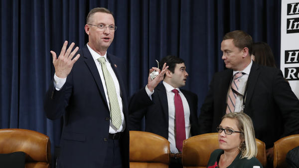 House Judiciary Committee ranking member Rep. Doug Collins, R-Ga., stands up as the committee abruptly adjourns without votes on the articles of impeachment against President Trump.