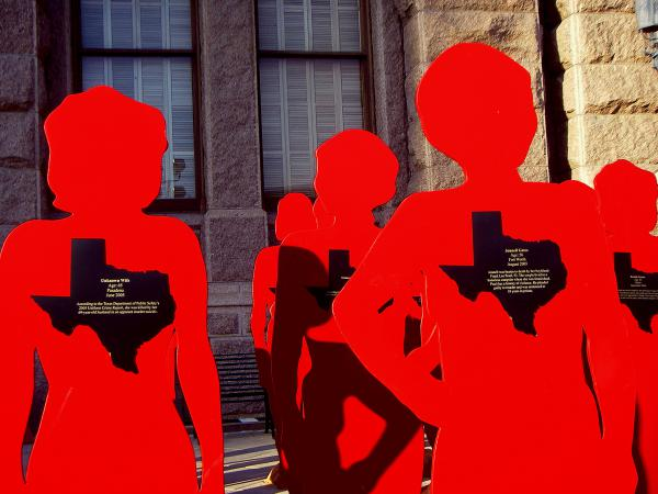 """""""Red Women"""" statues in front of the Texas Capitol in 2006, representing women who have died from domestic violence. The statues were a project of the Texas Conference on Family Violence."""