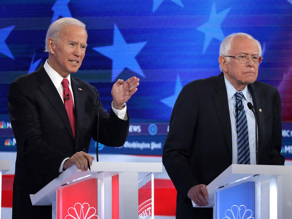 Former Vice President Joe Biden (left) and Sen. Bernie Sanders lead the crowded Democratic presidential primary field, according to the latest NPR/<em>PBS NewsHour/</em>Marist Poll. Above, they appear during the Democratic presidential primary debate in Atlanta on Nov. 20.