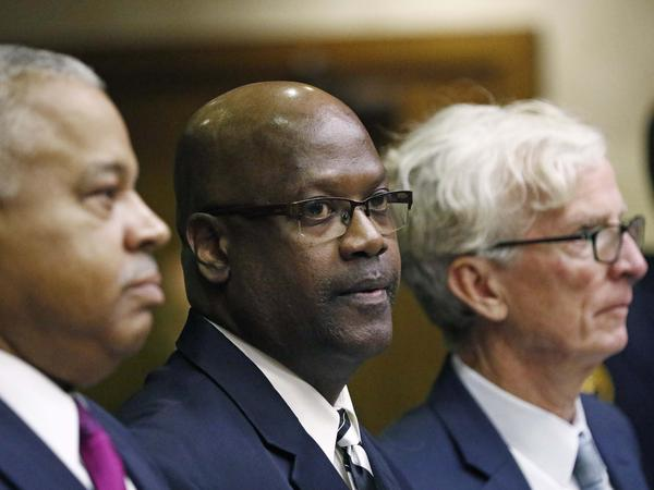 Curtis Flowers (center) appears in court in Winona, Miss., on Monday for a bail hearing. His 2010 conviction on murder charges was reversed in June by the U.S. Supreme Court, which ruled that prosecutors had excluded black people from the jury.