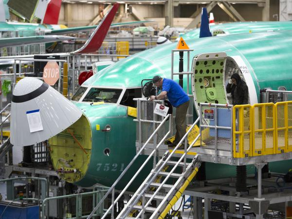 Boeing is the top U.S. exporter, and its decision to suspend production of the 737 Max is expected to ripple through the manufacturing supply chain and bring down economic growth.